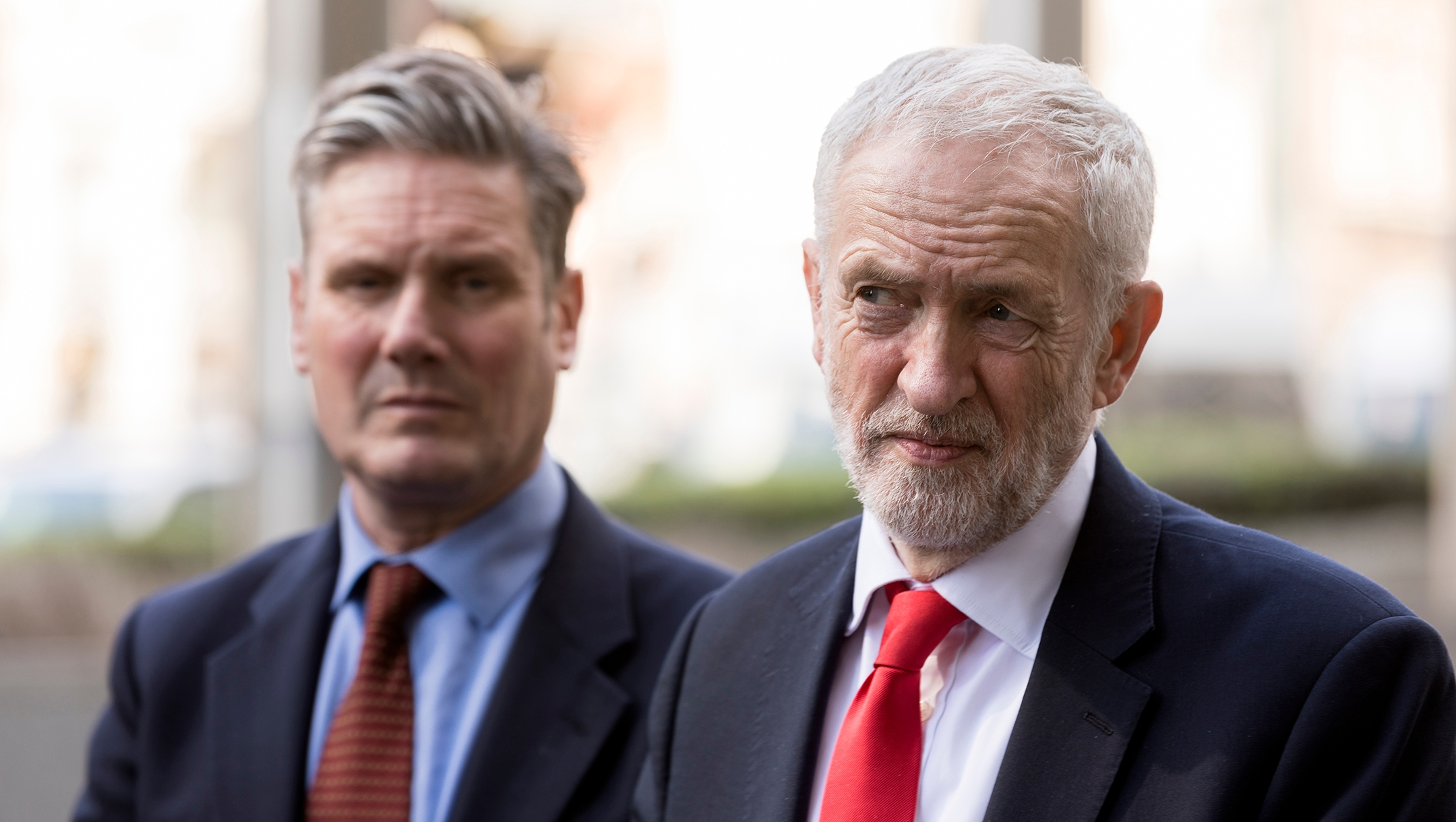 Corbyn suspended from Labour after report finds the British party committed 'unlawful harassment' against Jews