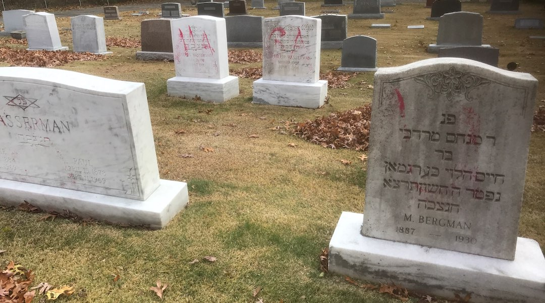 """Graves are tagged with graffiti reading """"MAGA"""" at a Jewish cemetery in Grand Rapids. (Courtesy of the ADL)"""