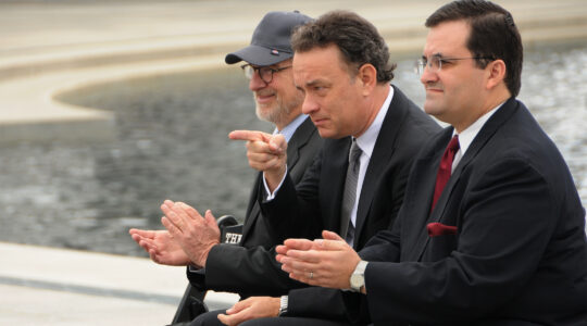 Actor Tom Hanks, center, points to veterans at the World War II Memorial in Washington, DC on March 11, 2010.(Wikimedia Commons)
