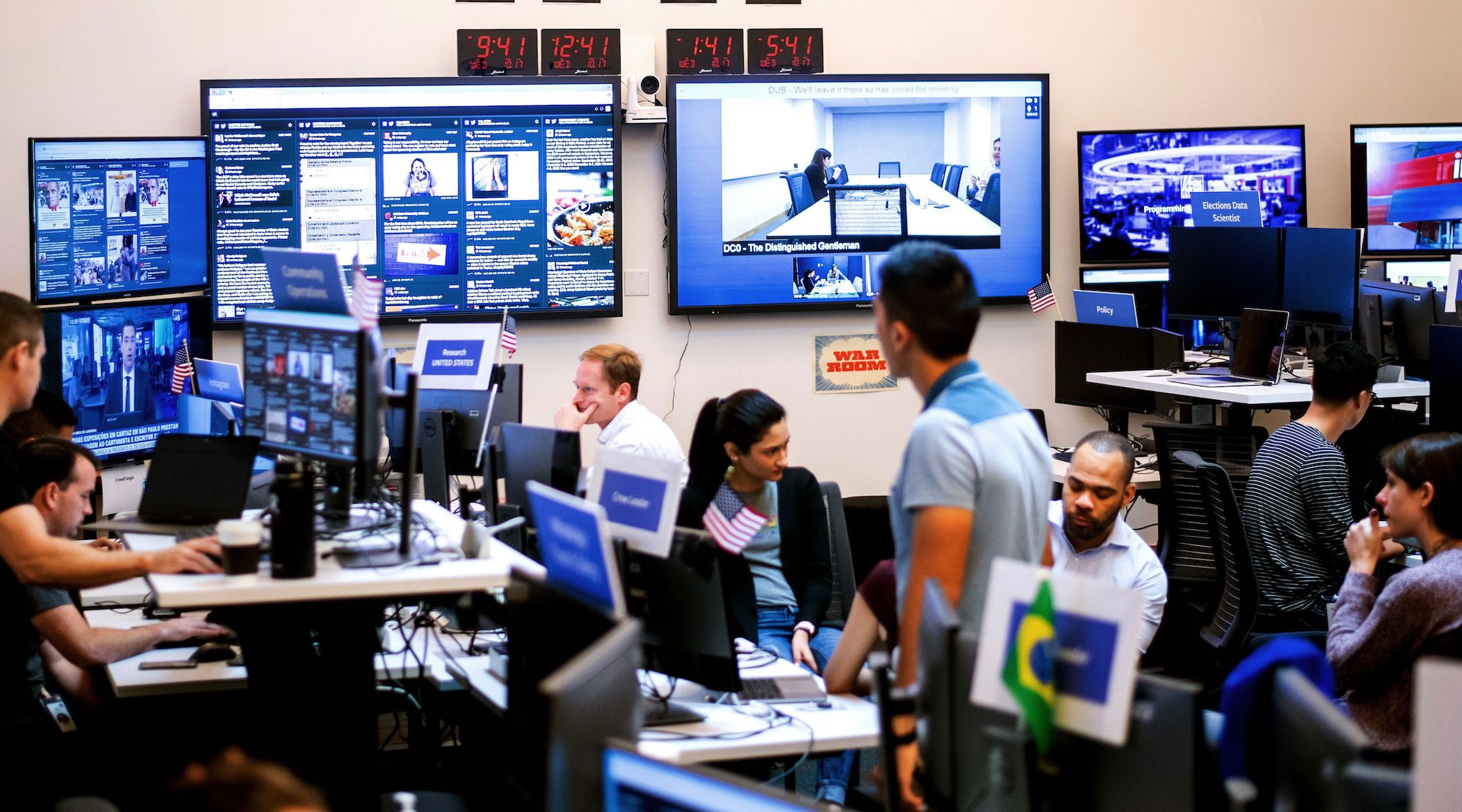 Employees work in a Facebook unit focused on the fight against misinformation and manipulation in Menlo Park, California in 2018. (Noah Berger/AFP via Getty Images)