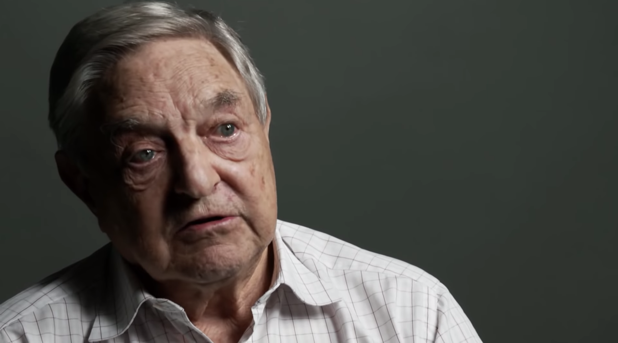 A new documentary about George Soros, pictured above giving an interview in the film's trailer, has been called a 'hagiography.' (Screenshot)