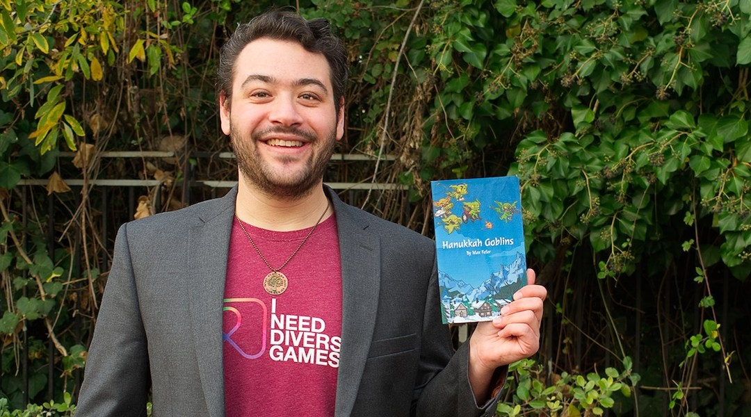 Max Fefer of Oakland is the designer of Hanukkah Goblins, a new tabletop role-playing game. (Photo/Wesley Guo)