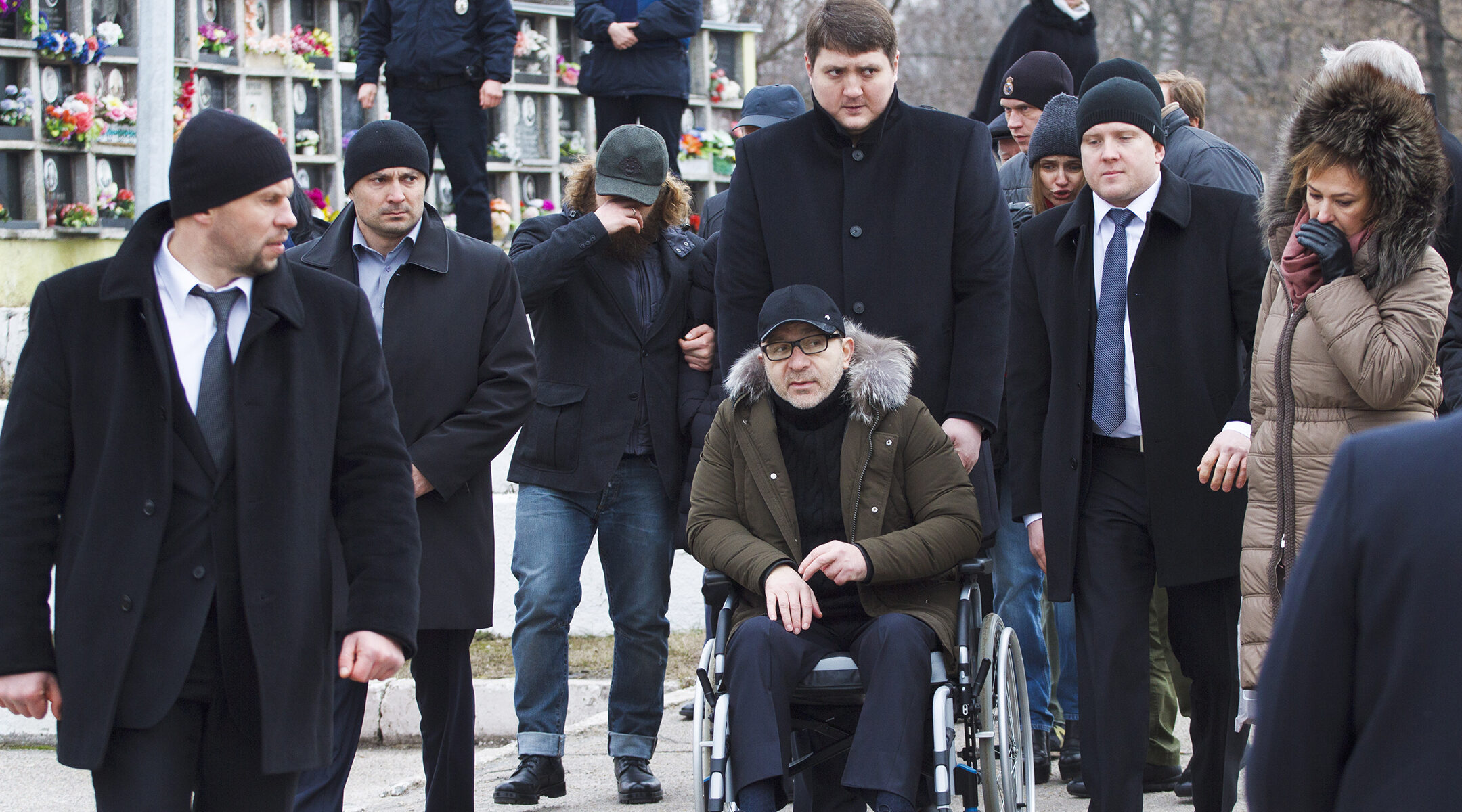 Gennady Kernes, in a wheelchair, attends the funeral of his associate and close friend, businessman Yuri Diment, at the Jewish cemetery of Kharkiv, Ukraine on Feb. 26, 2016. (Konstantin Cherginsky/TASS via Getty Images)