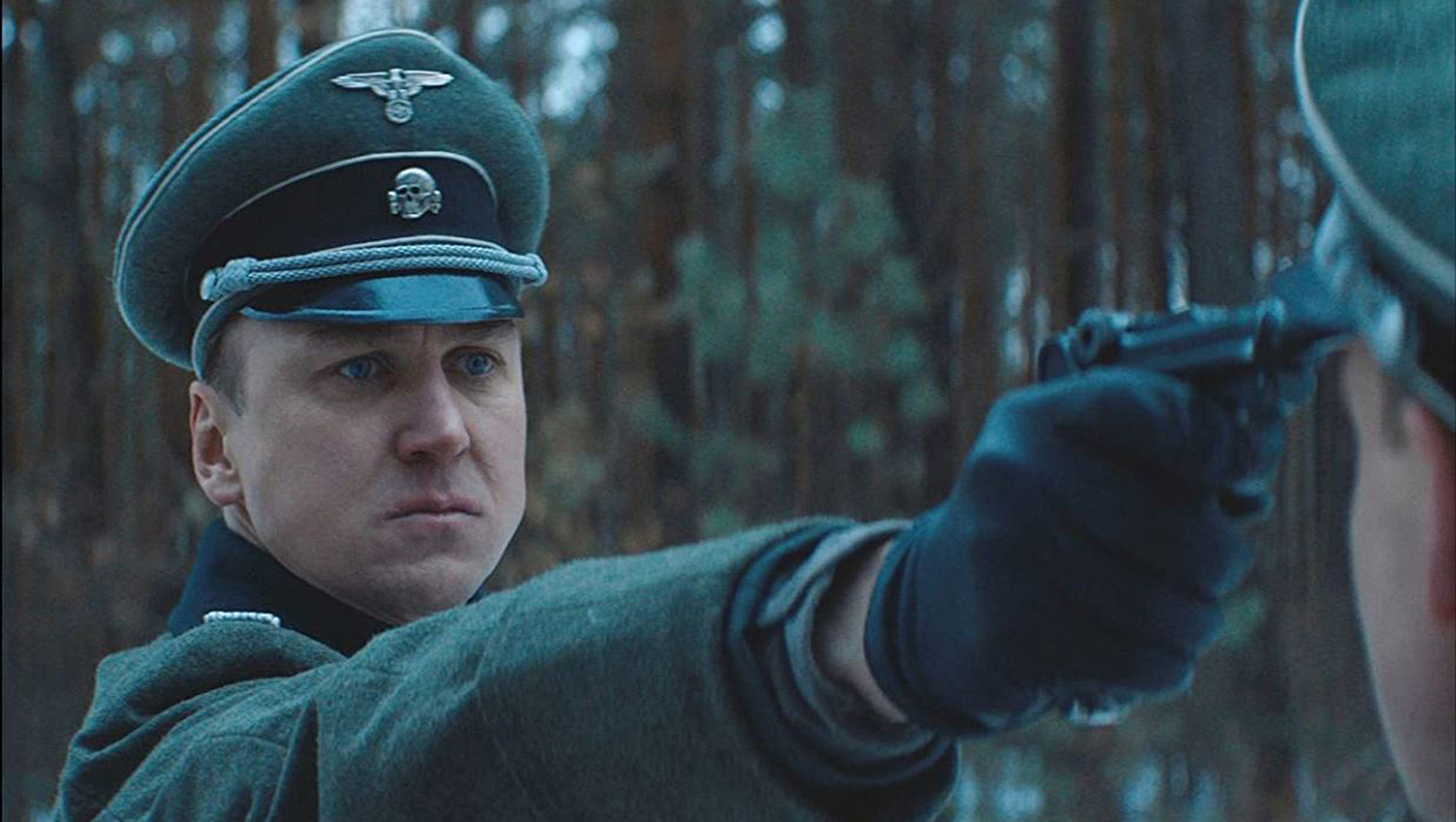 Actor Lars Eidinger portrays a Nazi officer at a concentration camp during filming in Belarus of the film 'Persian Lessons' in 2019. (Courtesy of HyperFilms)