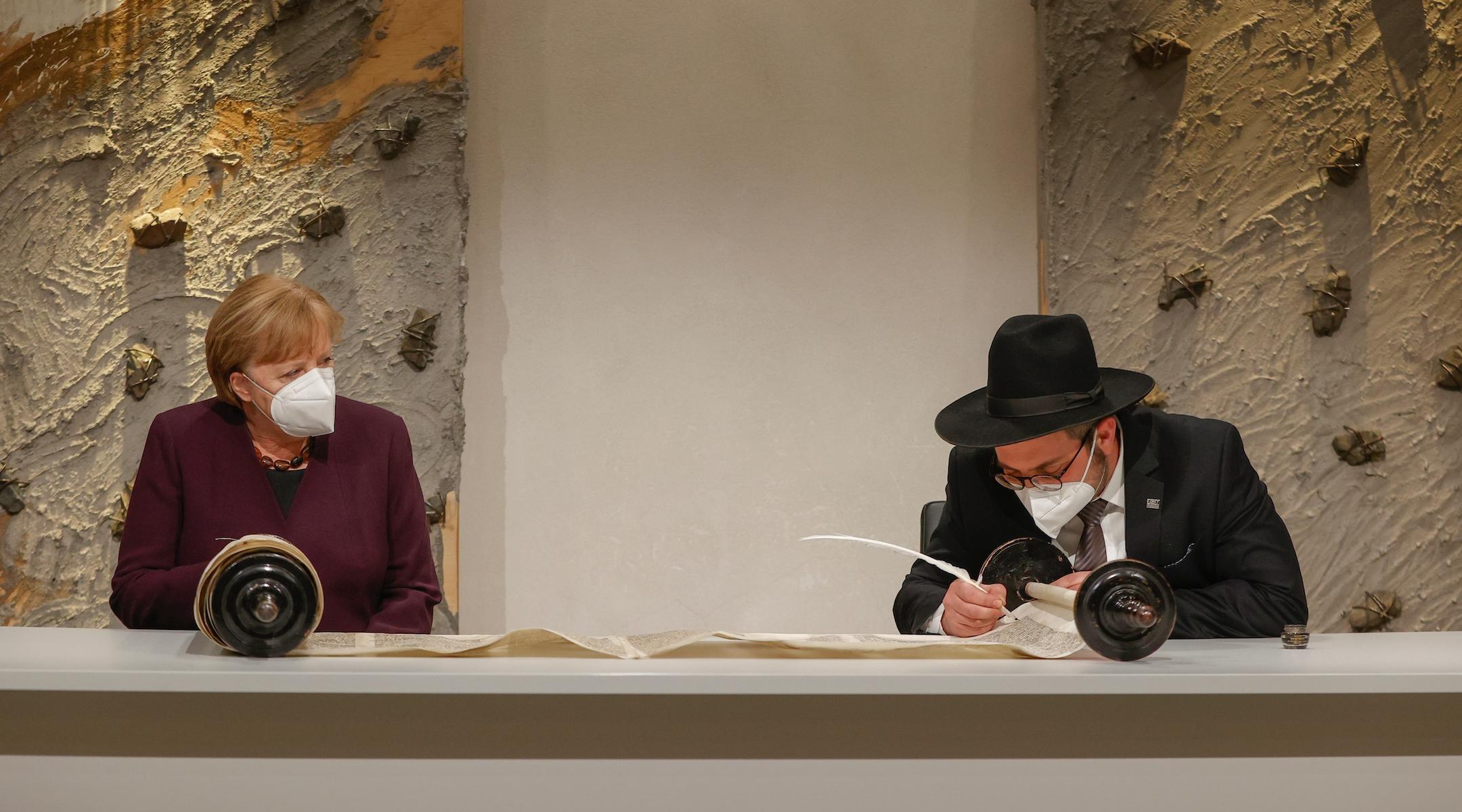 Angela Merkel participates in historic Torah scroll writing ceremony