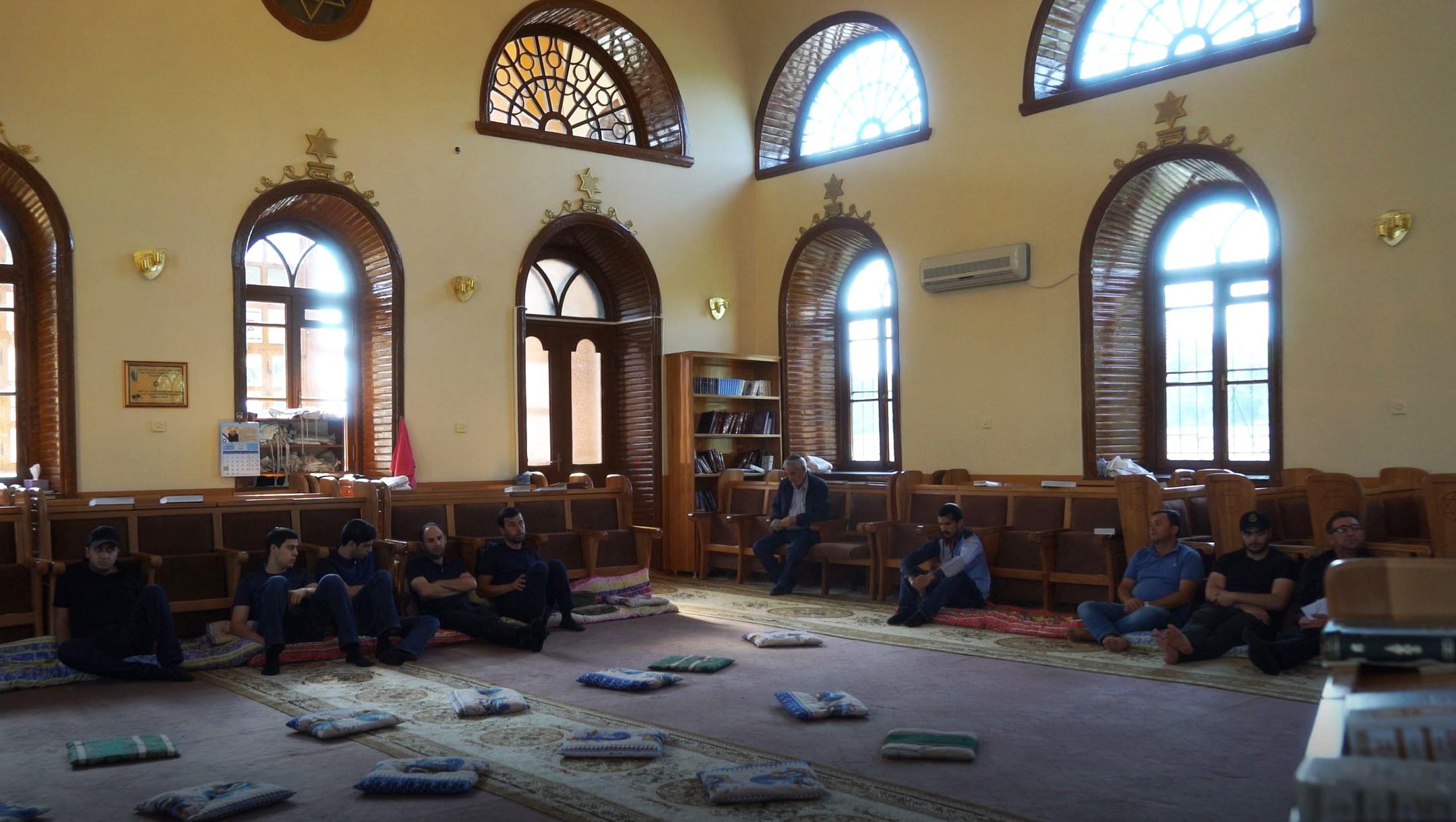 Men pray at the Six Dome Synagogue of Krasnaiya Sloboda, Azerbaijan on July 21, 2018. (Cnaan Liphshiz)