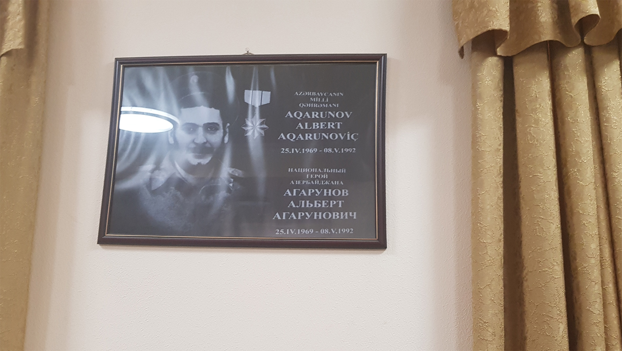 A picture of a Jewish casualty of war from 1992 hangs in the Georgian Synagogue of Baku, Azerbaijan in July 2018. (Cnaan Liphshiz)