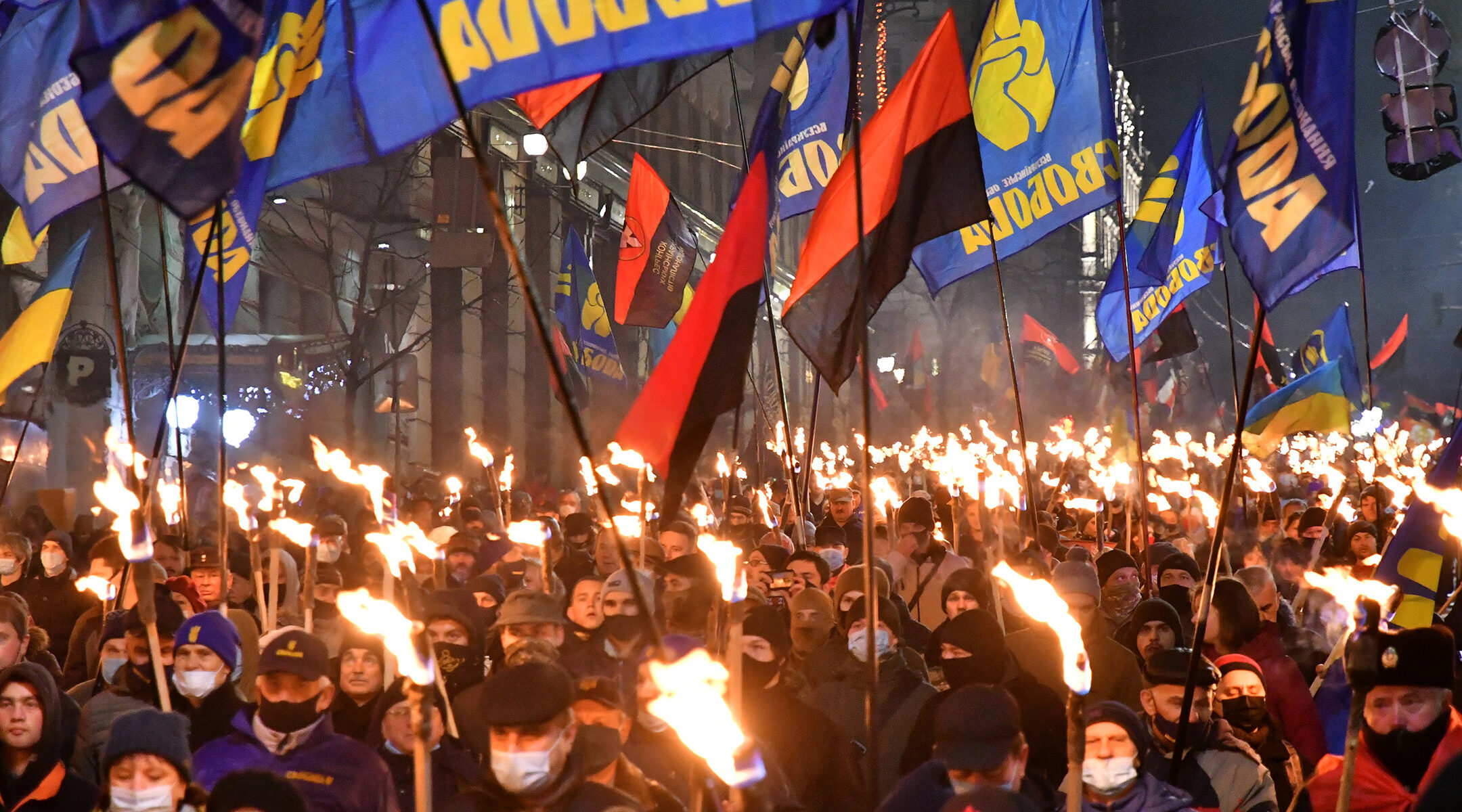 Participants of an annual event in honor of Stepan Bandera march through Kyiv, Ukraine on Jan. 1, 2021. (Genya Savilou/AFP via Getty Images)