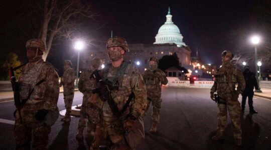 Members of the U.S. National Guard deploy around the U.S. Capitol on January 12, 2021 in Washington, DC. Fears of extremist protests across the United States remain a week after the storming of the Capitol and ahead of Joe Biden's inauguration. (Andrew Caballero-Reynolds/AFP via Getty Images)
