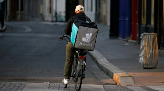 A deliveryman for Deliveroo rides his bike in Paris, France on April 12, 2020. (Chesnot/Getty Images)