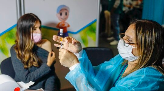 An Israeli healthcare worker prepares a dose of the COVID-19 vaccine at a health clinic in Jerusalem on January 14, 2021. (Ahmad Gharabli/AFP via Getty Images)