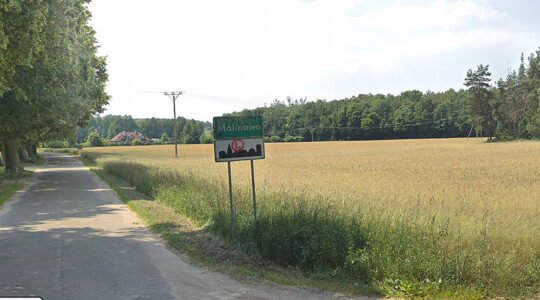 A sign at the entrance to the village of Malinowo, Poland. (Google Maps)