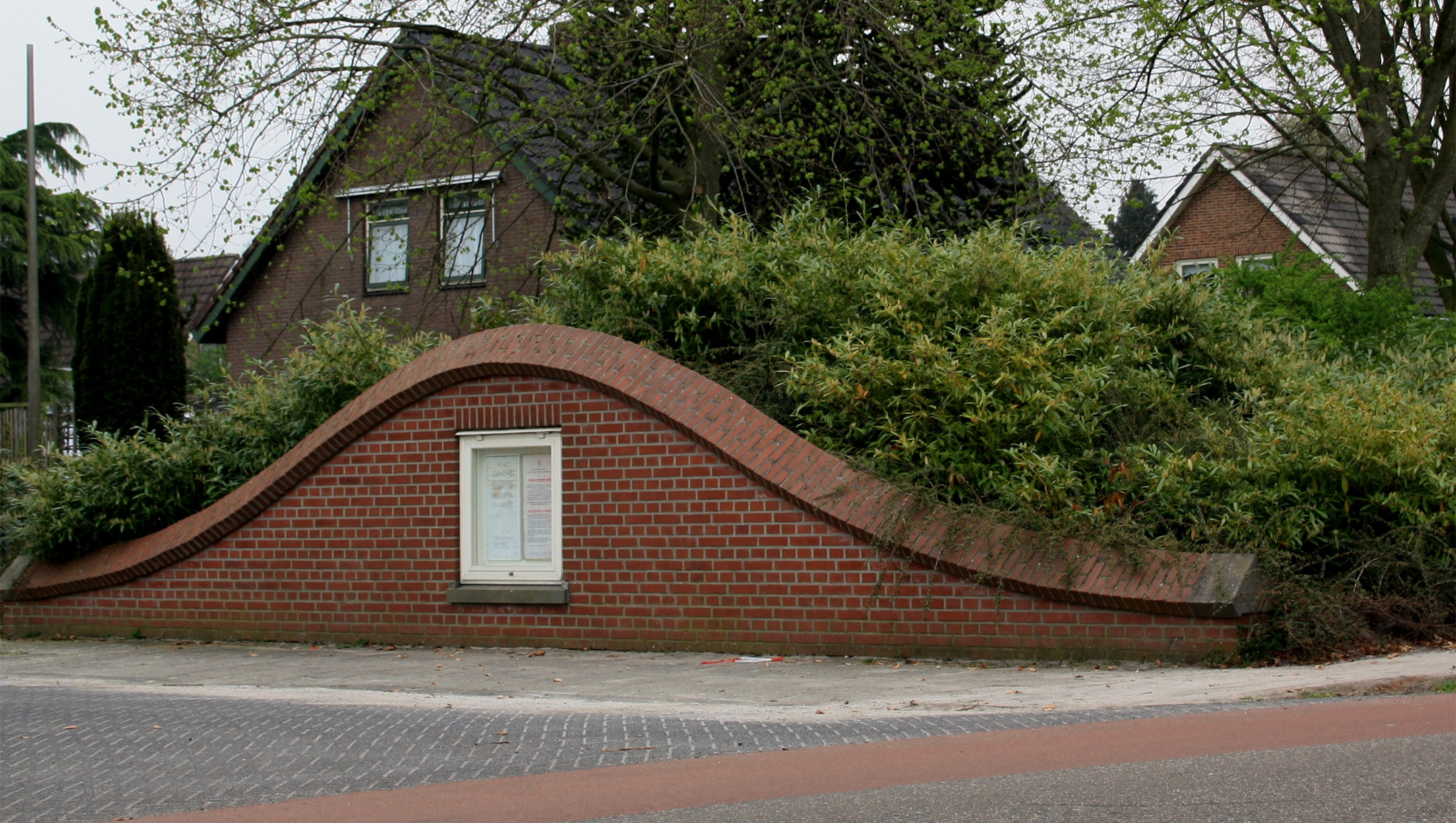 A copy of a certificate from Yad Vashem features prominently on the wartime monument of Nieuwlande, the Netherlands, which is designed to resemble a dugout for hiding Jews during the Holocaust. (Wikimedia Commons)
