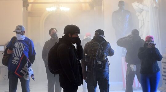 A pro-Trump mob enters the US Capitol as tear gas fills the corridor on January 6, 2021. (Saul Loeb/AFP via Getty Images)