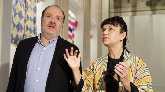 Alexander Klyachin listens to and Marina Loshak, director of the Pushkin State Museum at her institution in Moscow, Russia on Sept. 30, 2019. (Mikhail Metzel\TASS via Getty Images)
