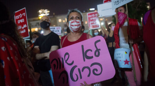 Activists protest violence against women at Habima square in Tel Aviv on October 21, 2020. (Miriam Alster/Flash90)