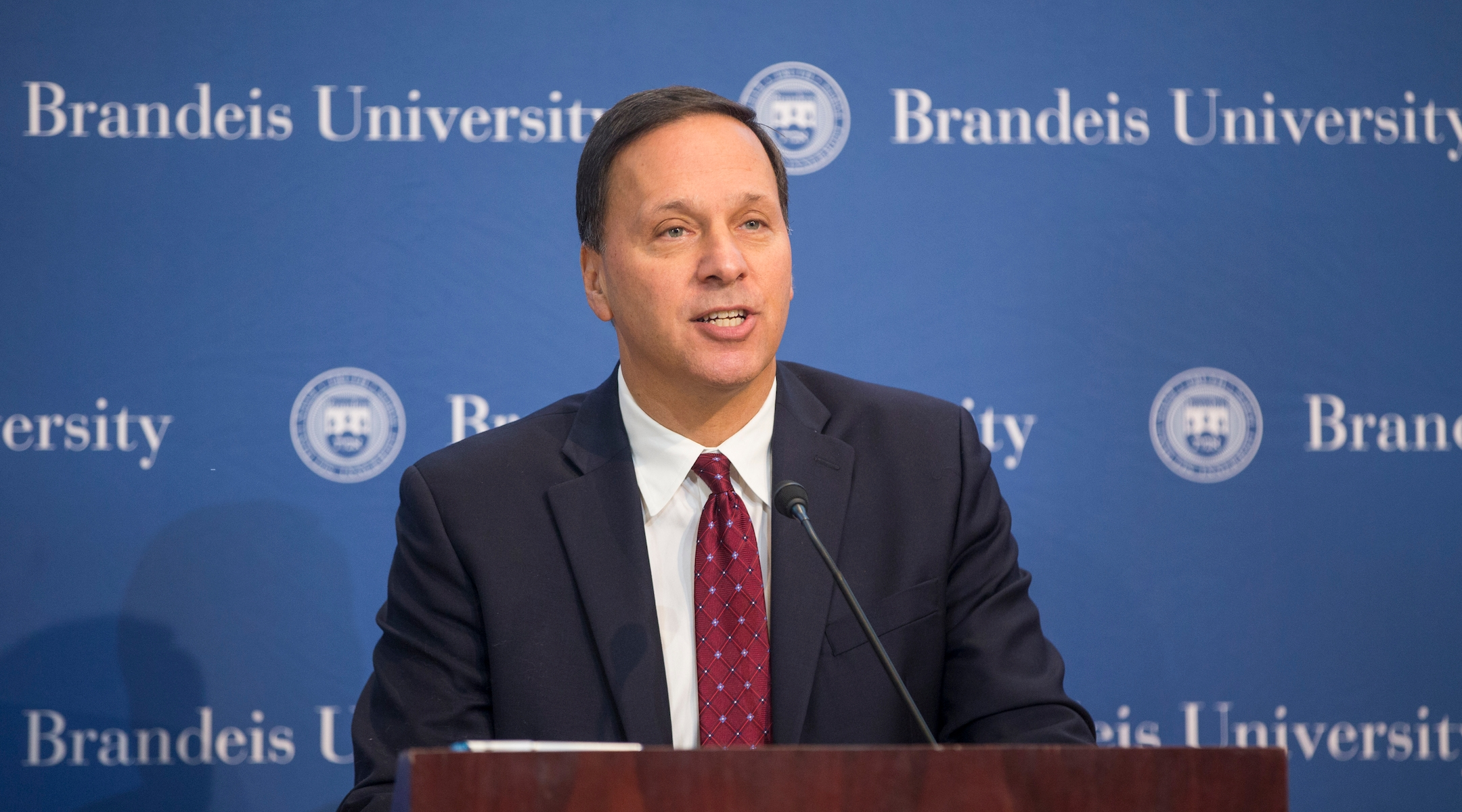 Brandeis president signs 5-year contract renewal after dispute with university's board
