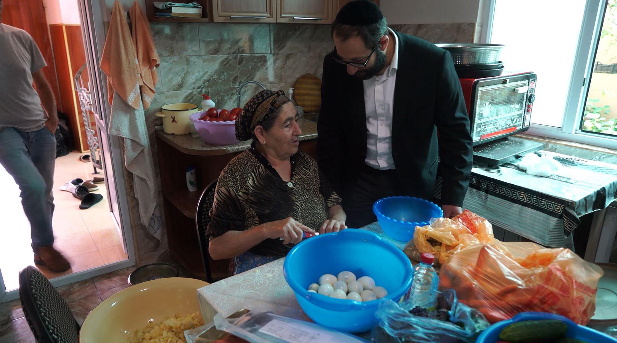 Zoya Avadayev discusses cooking Jewish dishes with Rabbi Tsadok Ashurov Krasnaiya Sloboda, Azerbaijan on July 21, 2018. (Cnaan Liphshiz)