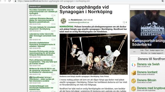 The website of the Nordic Resistance Movement features a picture of dolls hanged outside the synagogue of Norrkoping, Sweden on March 28, 2021. (NRM)