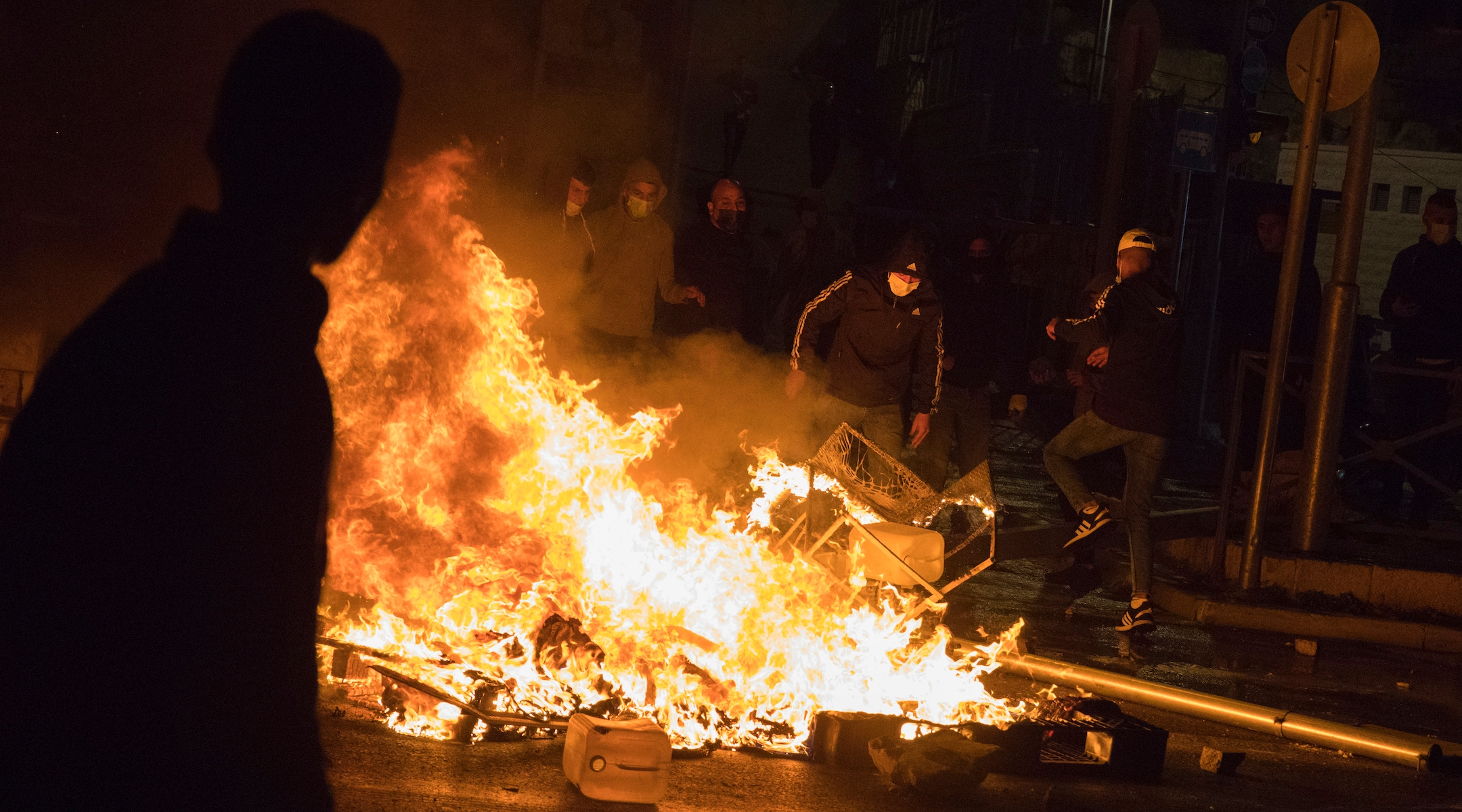 A fire burns amid violent protests in Jerusalem on April 22, 2021. (Olivier Fitoussi/Flash90)