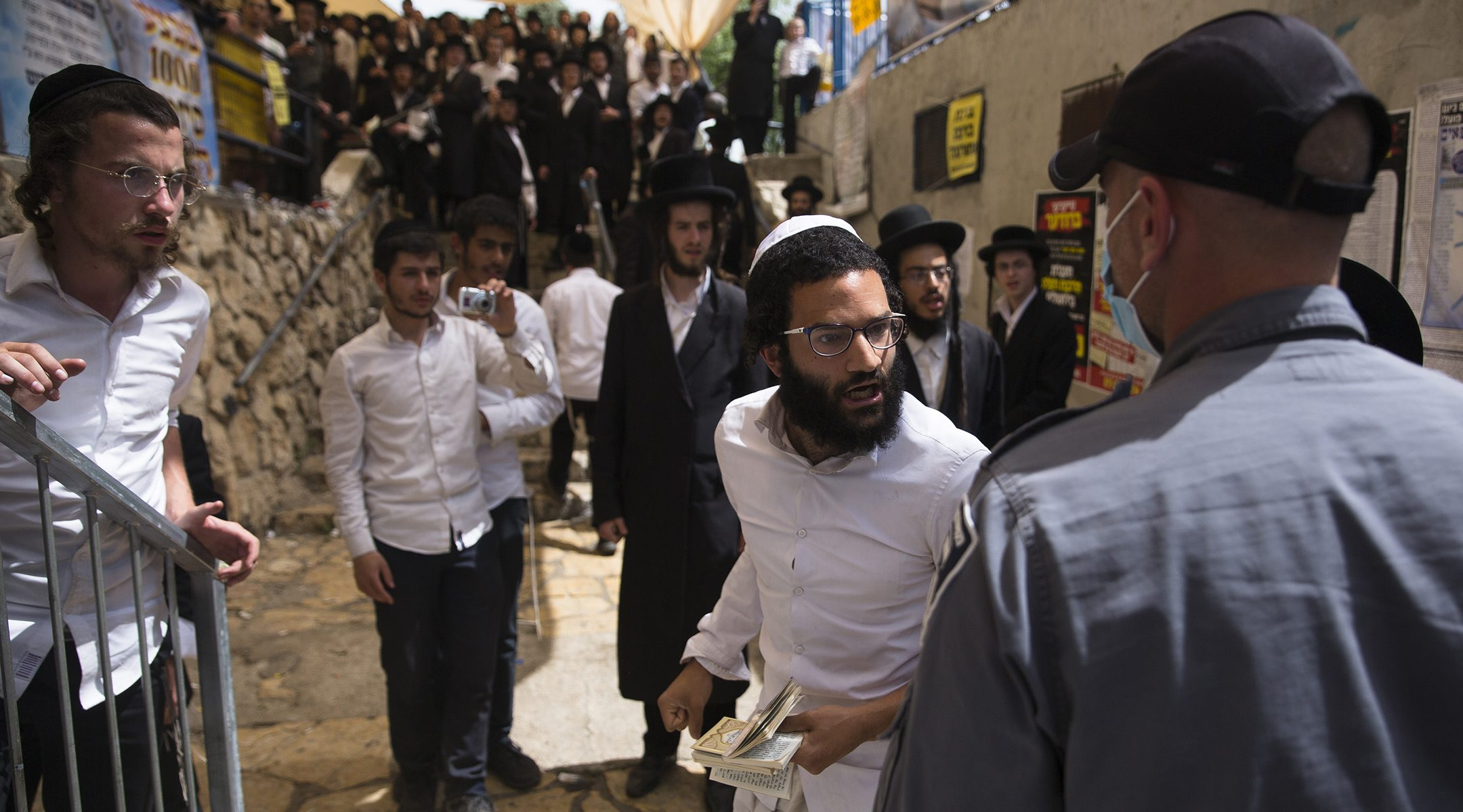 Mourners gather during the funeral of one of those who died in a stampede during the Jewish religious festival of Lag Ba'Omer at the Jewish Orthodox pilgrimage site of Mount Meron in Israel on April 30, 2021. (Ilia Yefimovich/picture alliance via Getty Images)