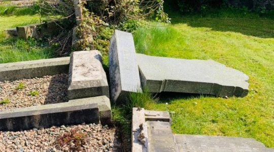 The aftermath of vandalism at the Jewish section of a municipal cemetery in Belfast, UK on April 16, 2021. (Courtesy of Steven Corr)