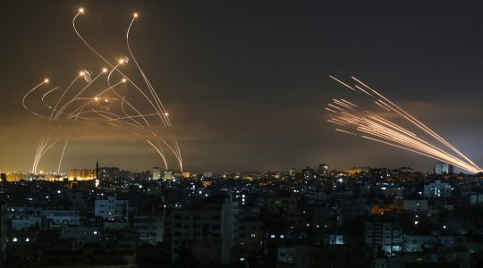 The Iron Dome interceptors (left) meet a volley of missiles from Gaza (right) on May 14, 2021. (Anas Baba/AFP via Getty Images)