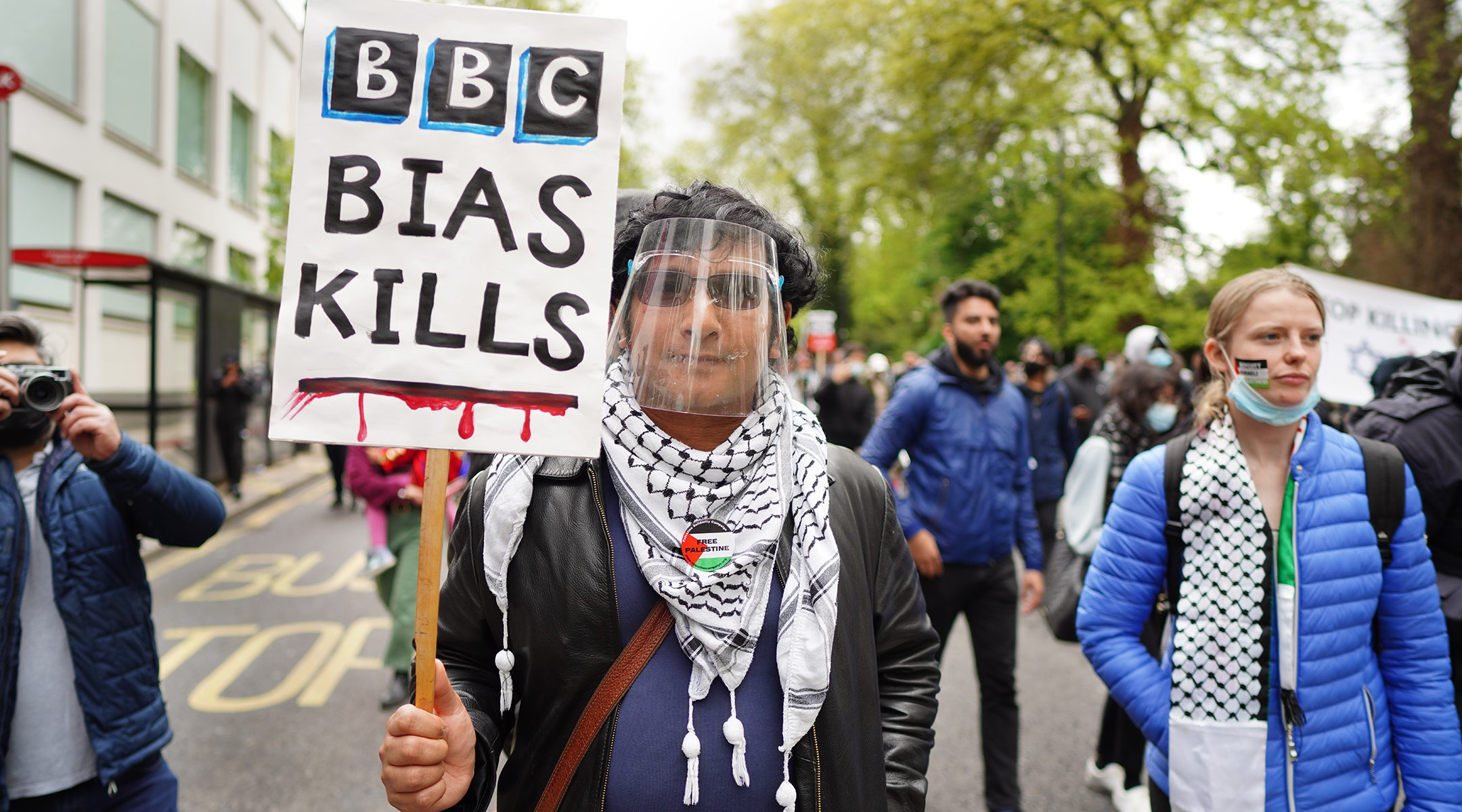A protester marches in London, the UK at a rally again Israel's actions in Gaza on May 16, 2021. (Alisdare Hickson)