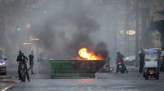 A dumpster set on fire in Yafo amid violent protests across Israel on May 11, 2021. (Avshalom Sassoni/FLASH90)