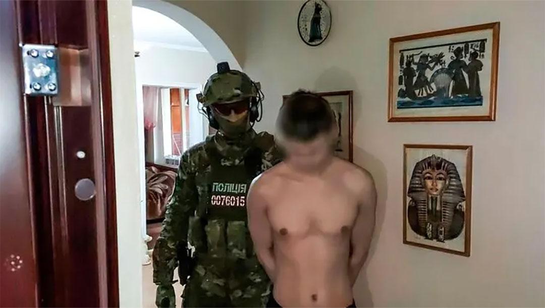 A 29-year-old man is taken into custody for the murder of Vladimir Shchukin in Nikolayev, Ukraine on May 25, 2021. (National Police of Ukraine)