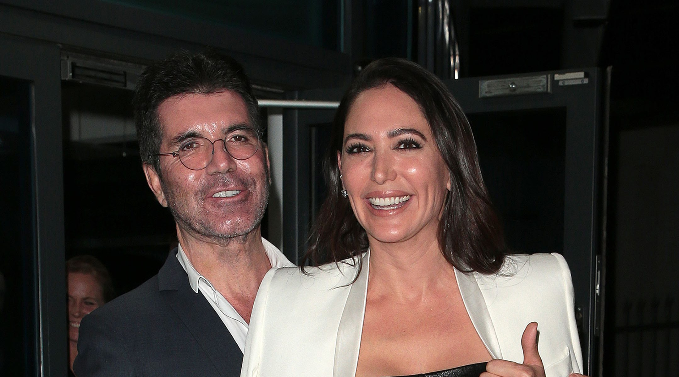 Simon Cowell and his wife Lauren Silverman leave LH2 studios after Celebrity X Factor on November 23, 2019 in London, UK. (Ricky Vigil M/GC Images)