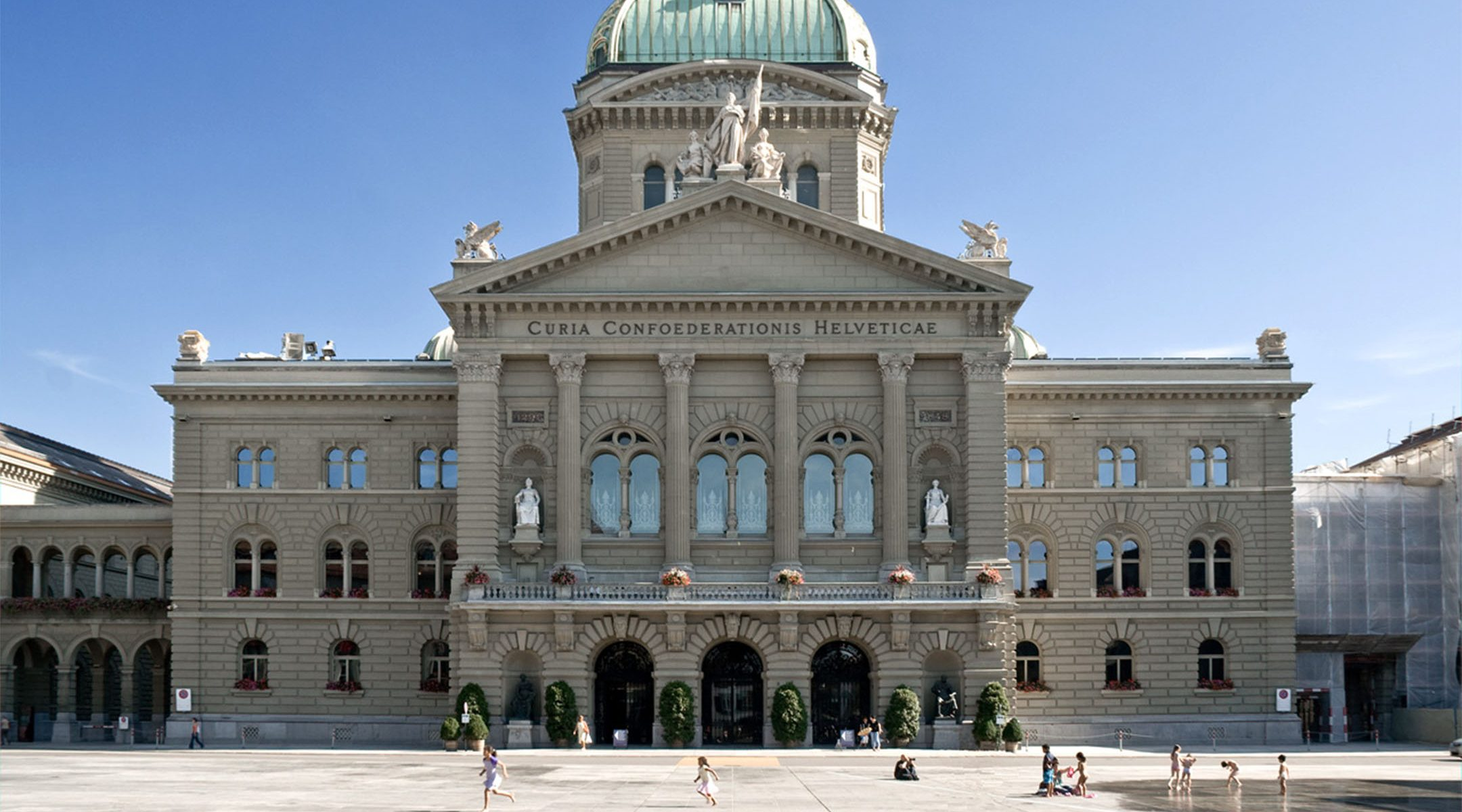 Children play outside the Federal Palace in Bern, Switzerland on July 21, 2009. (Wikimedia Commons)