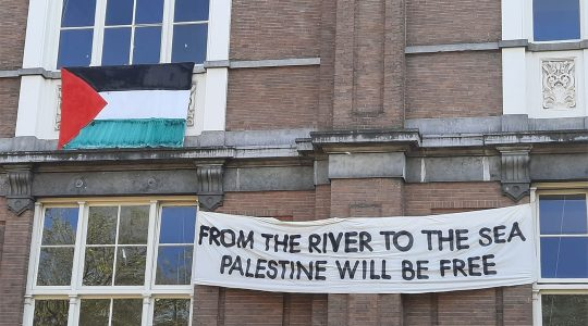 A banner about Israel hangs on the facade of the De Ateliers arts institution in Amsterdam, the Netherlands on May 28, 2021. (Barry Mehler)