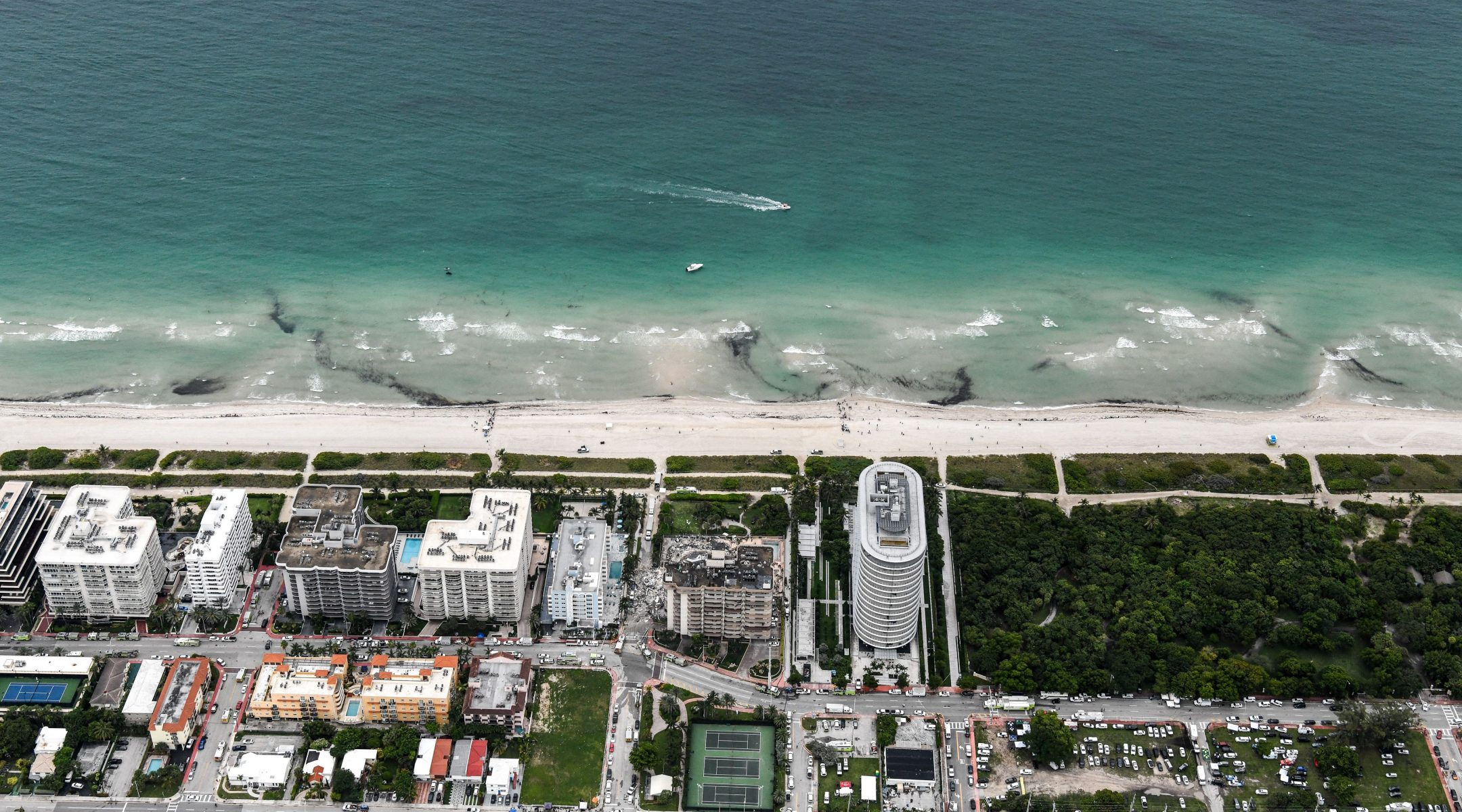 This aerial view shows search and rescue personnel working after the partial collapse of the Champlain Towers South in Surfside, north of Miami Beach, on June 24, 2021. (Chandan Khanna/AFP via Getty)