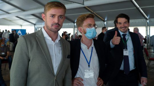 Marcel Goldhammer, left, Julian Potthast and Robert Eschricht attend a political event of their Alternative for Germany party in Berlin, Germany on June 14. (Courtesy of Goldhammer)