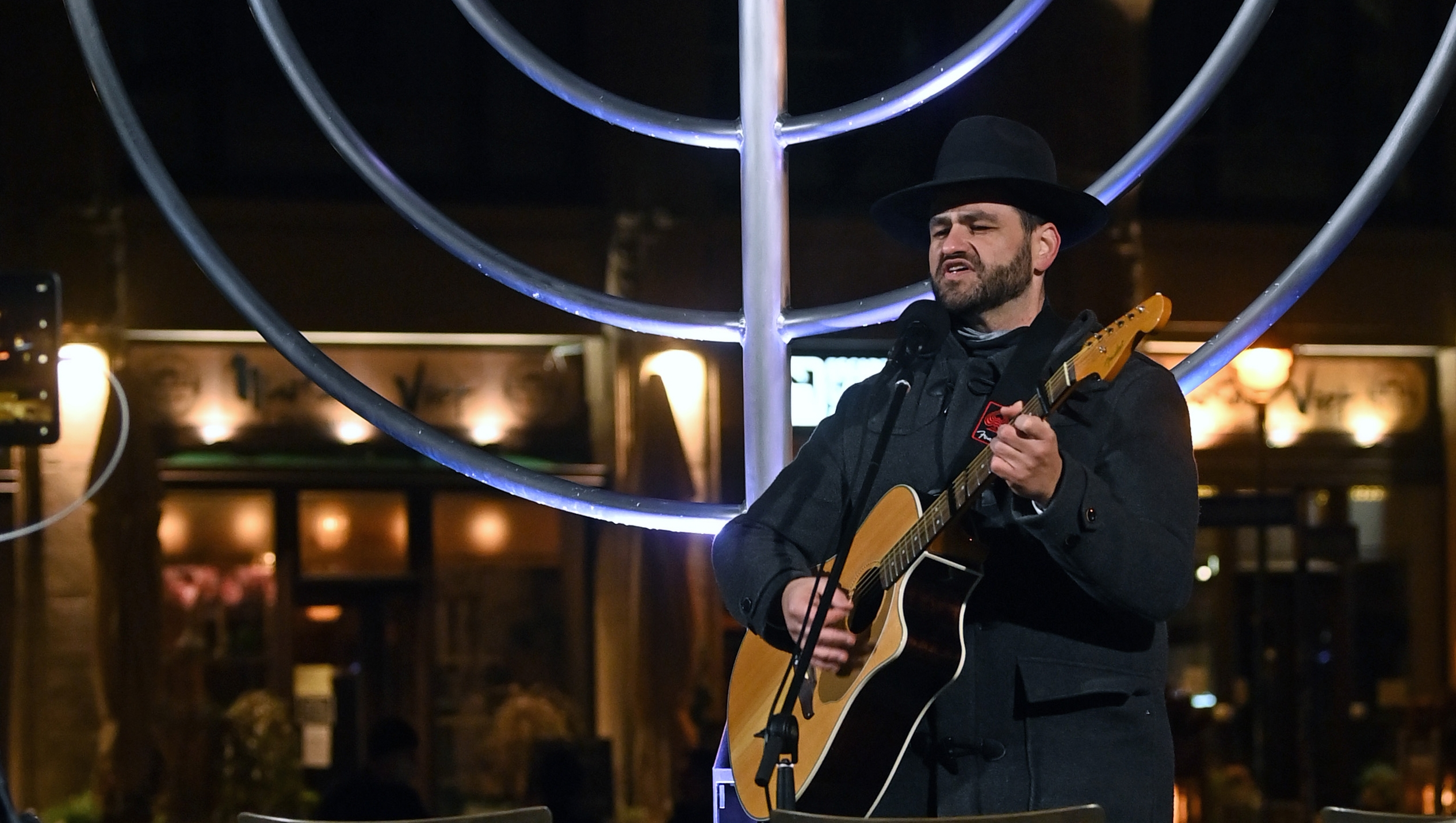 Rabbi Zsolt Balla sings at the memorial site of the former Great Synagogue of Leipzig, Germany on Dec. 10, 2020. (Hendrik Schmidt/picture alliance via Getty Images)