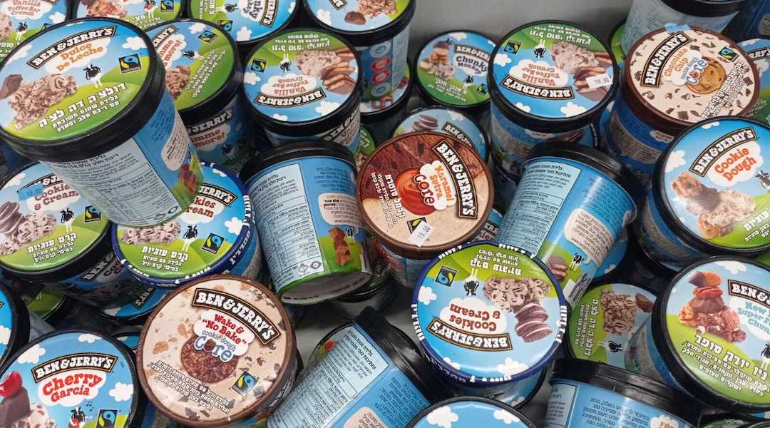A freezer full of Ben & Jerry's ice cream with Hebrew lettering on the labels