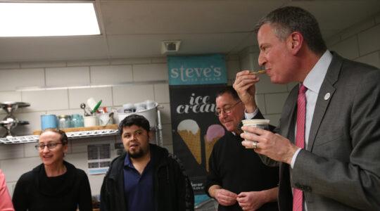 Mayor Bill de Blasio samples ice cream (not Ben & Jerry's) at Steve's Craft Ice Cream in Brooklyn on March 20, 2014. (Rob Bennett for the Office of Mayor Bill de Blasio)