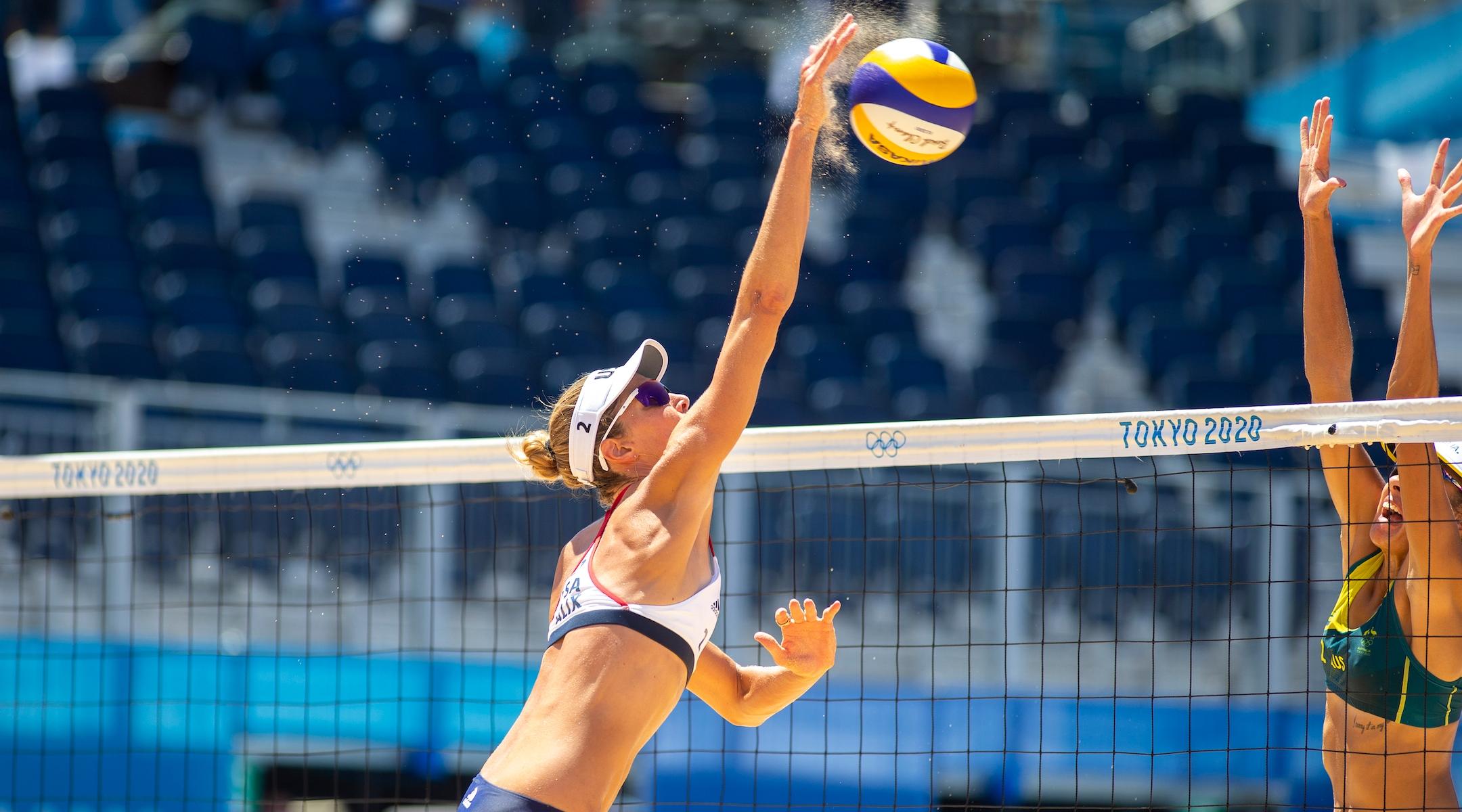Alix Klineman spikes a volleyball