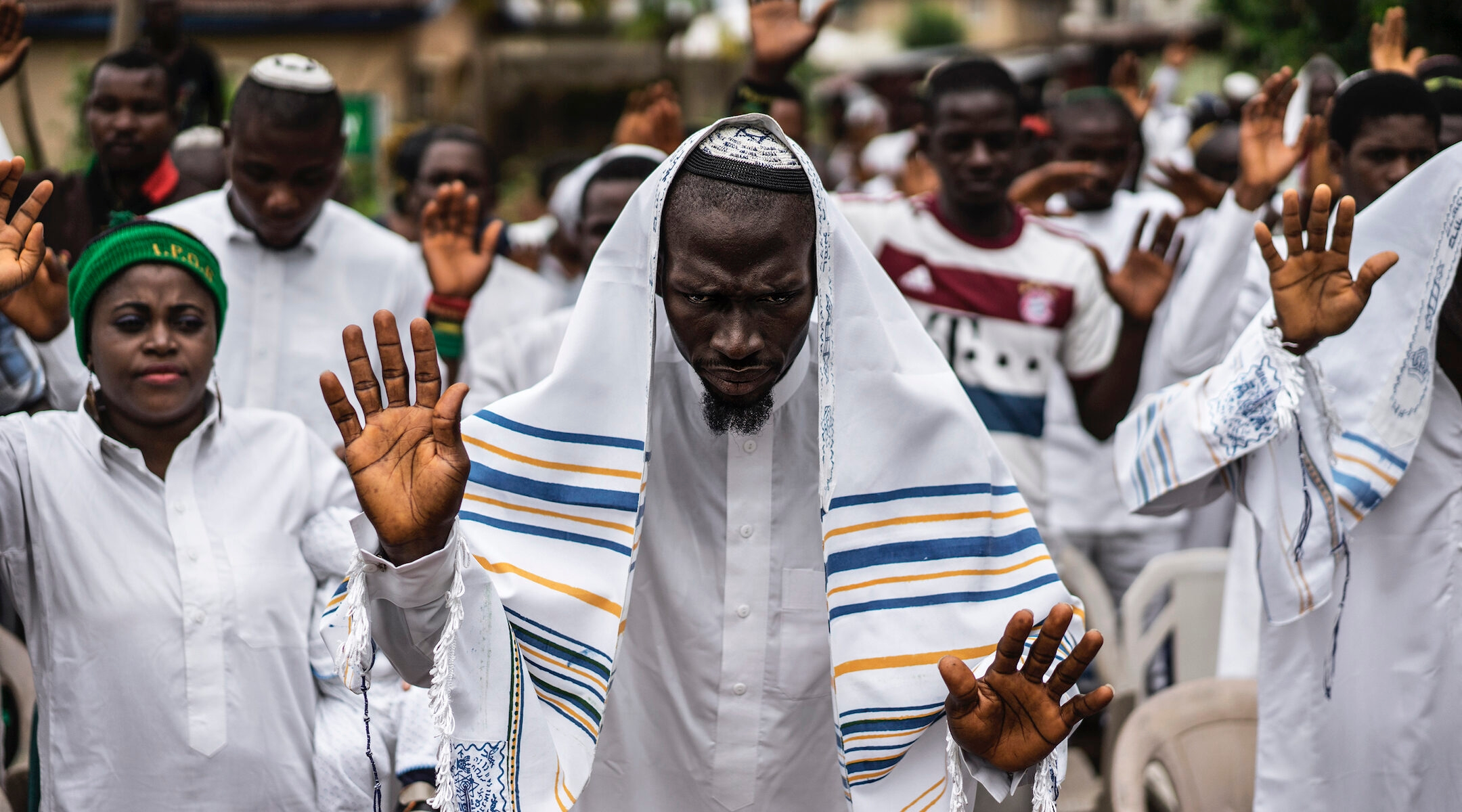 Nigerian worshippers celebrate Shabbat in 2017. The country's small Jewish community has become caught up in a separatist movement led by a Jewish activist. (Marco Longari/AFP via Getty Images)
