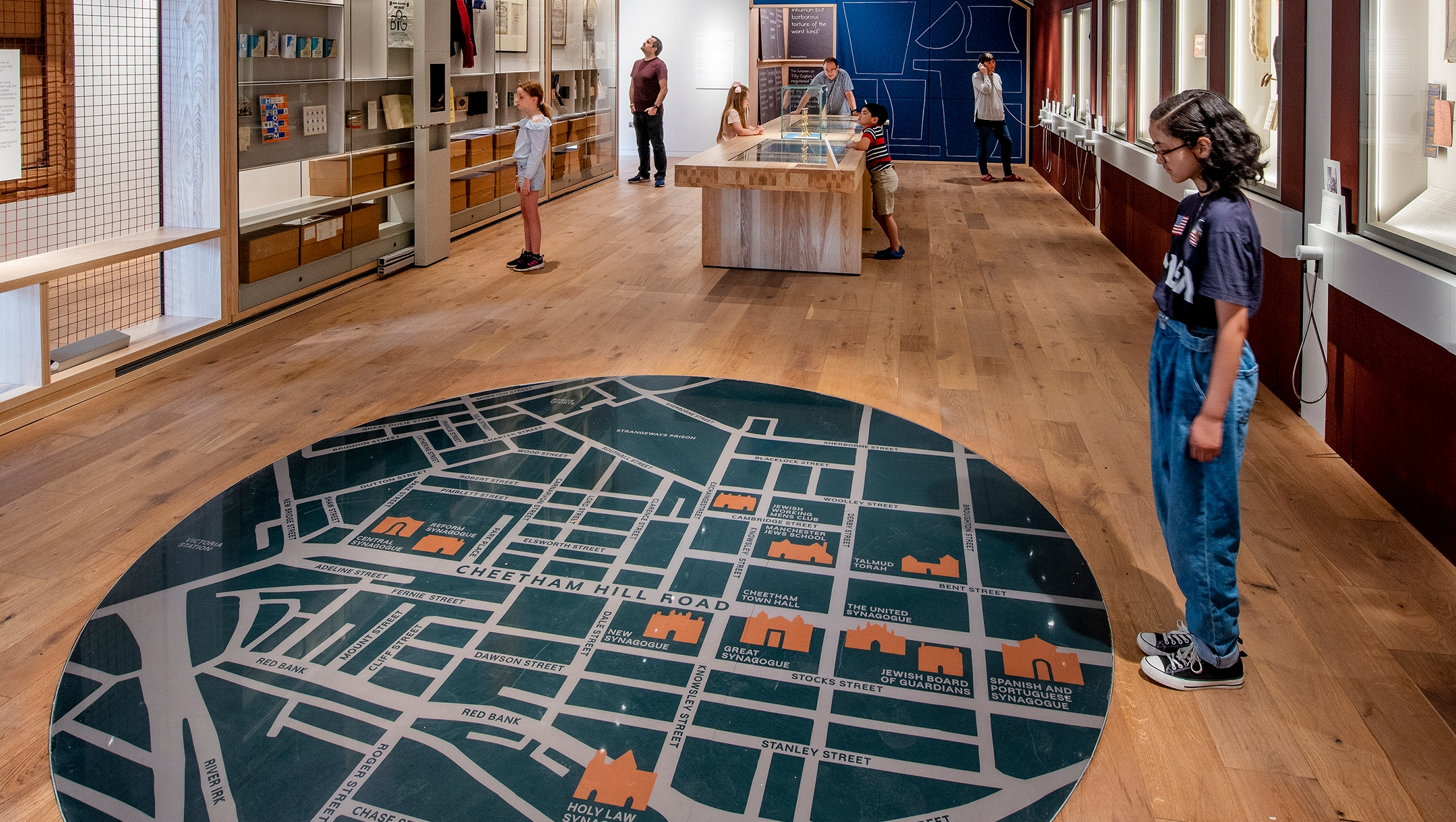 A child studies the giant map on the floor of the atrium of the Manchester Jewish Museum in Manchester, UK on June 4, 2021. (Chris Payne)