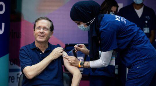 isaac herzog gets a third covid vaccine