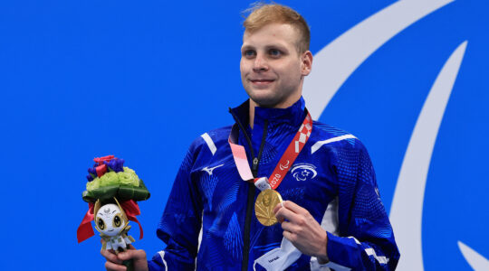 Mark Malyar poses during a medal ceremony
