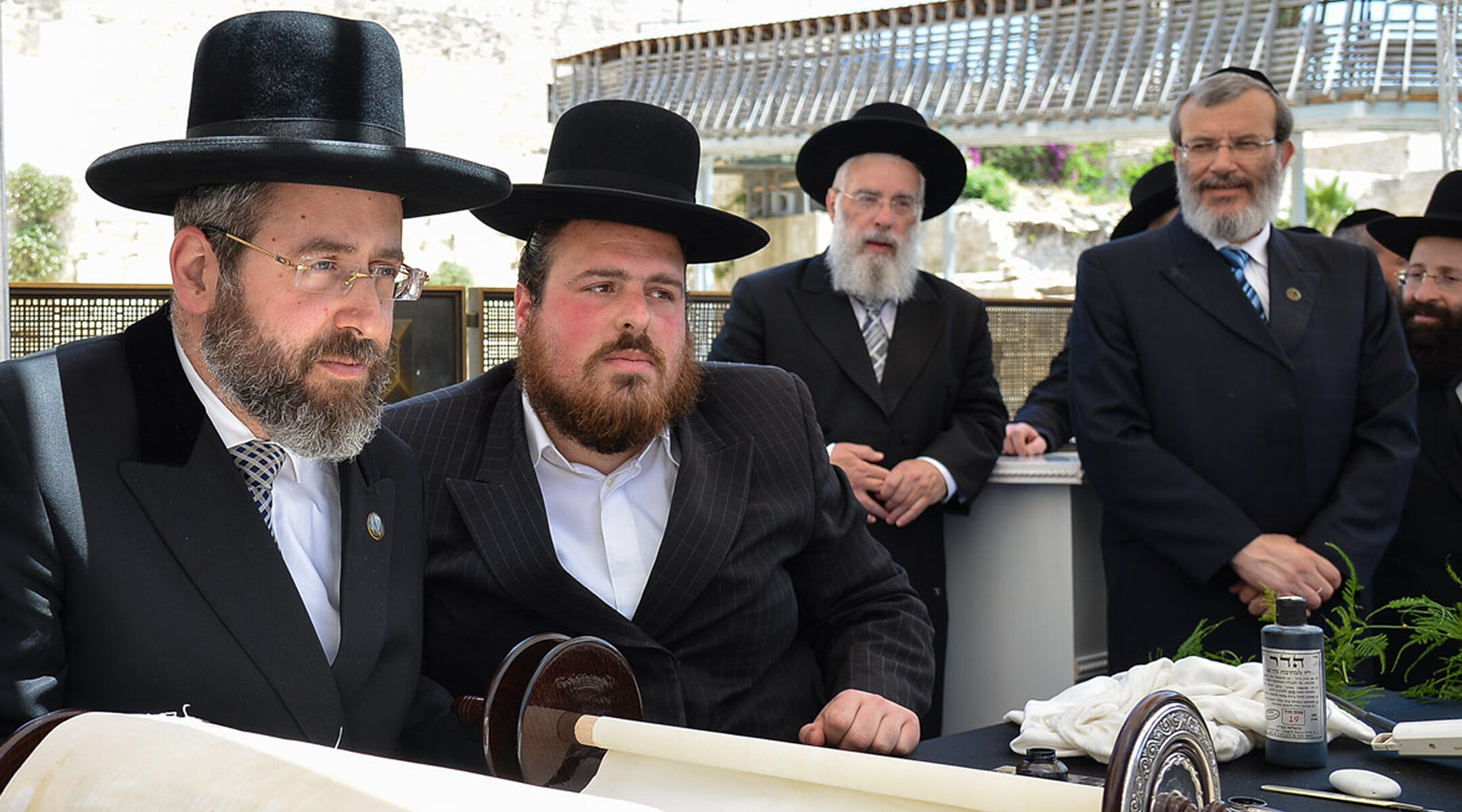 Chief Ashkenazi Rabbi David Lau, left, and other rabbis attend a Torah scroll completion ceremony in Jerusalem, Israel on June 15, 2015. (Eli Segal)