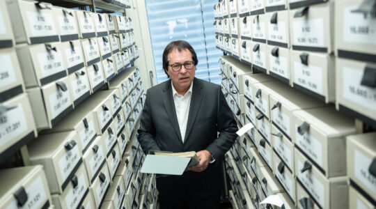 Thomas Will, head of the Central Office for the Investigation of National Socialist Crimes, stands among the office's files