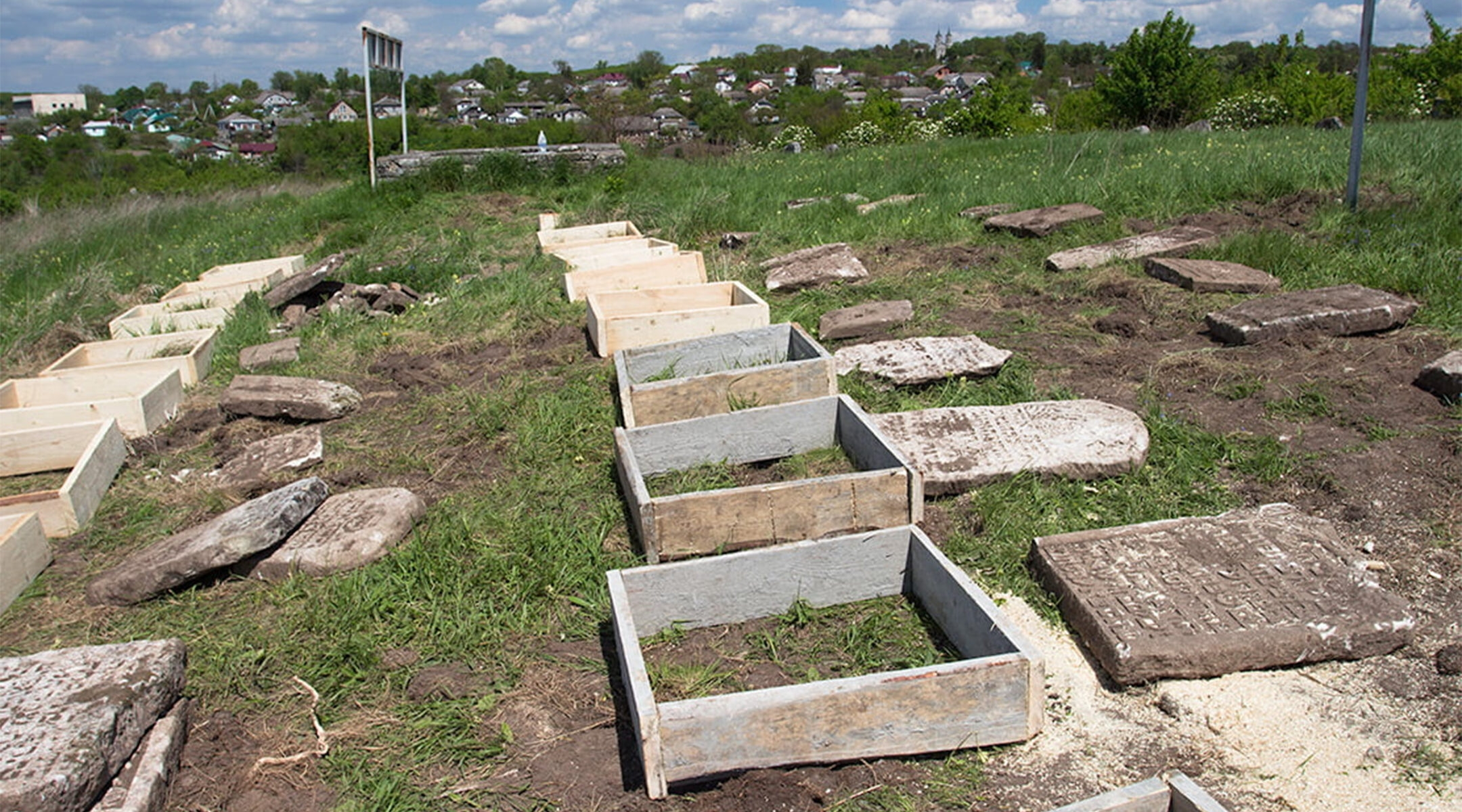 Renovation works at the Jewish cemetery in Sataniv, Ukraine in 2021. (Dmitry Polyukhovich/Jewish Heritage Europe)