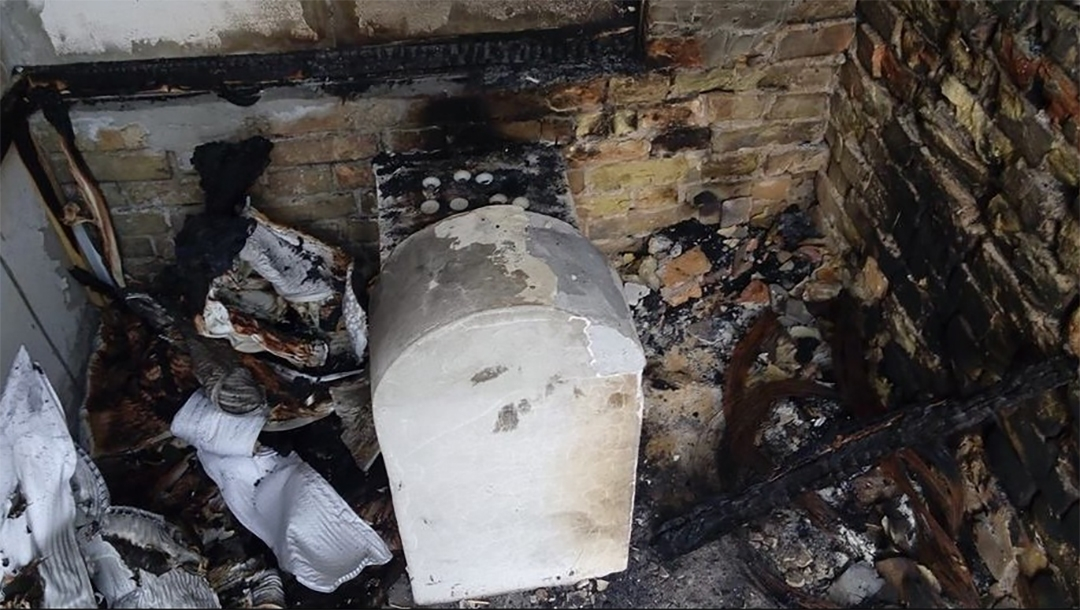 The torched grave of a daughter of Rabbi Nachman of Breslov in Kremenchuk, Ukraine in 2015. (Oholei Tzadikim)