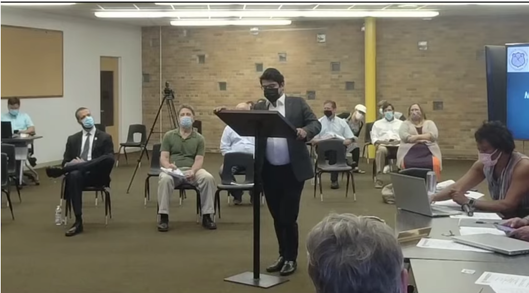 A rabbi speaks at a city council meeting
