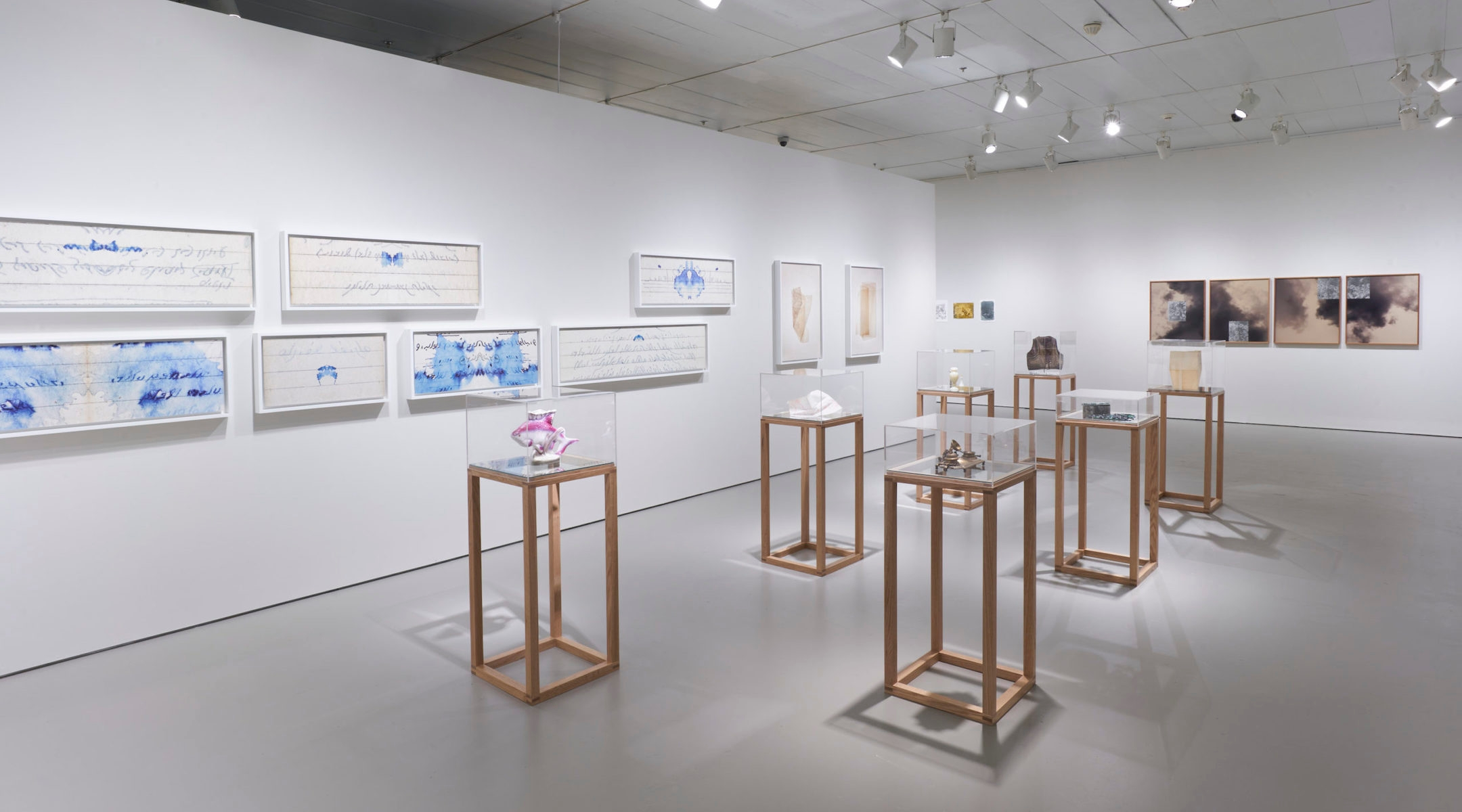 """Dor Guez, """"Letters from the Greater Maghreb"""" and """"Belly of the Boat"""", and collages by Lisa Oppenheim. Installation view by Steven Paneccasio."""