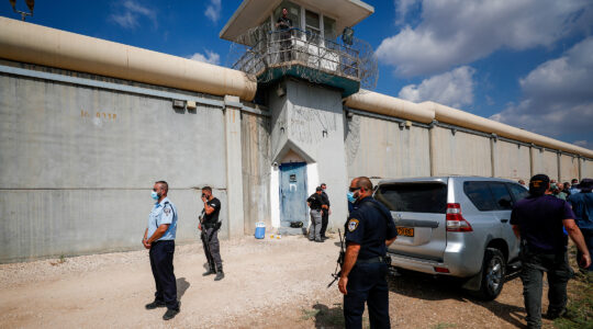 Police officers and prison guards inspect the scene of a prison escape of six Palestinian prisoners, outside the Gilboa prison in northern Israel on Sept. 6, 2021. (Flash90)